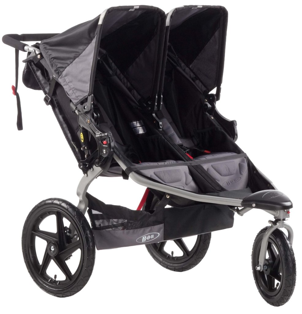 The BOB Revolution SE Dually is perfect for twins plus one because the front of the stroller is big enough for tired toddlers to sit and rest on when you stop.