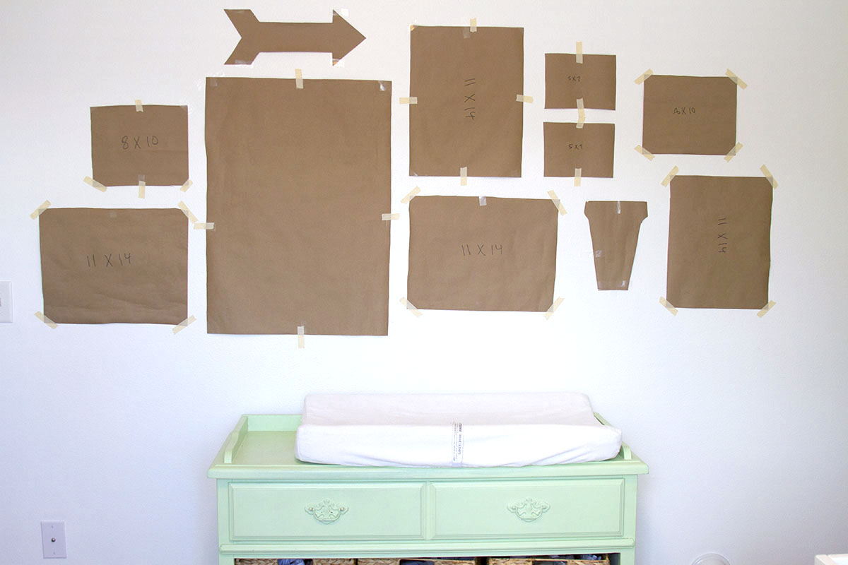 Gallery Wall Tips and Tricks | Great tips for putting up a gallery wall and an awesome simple trick for hanging everything! | BusyMommyMedia.com