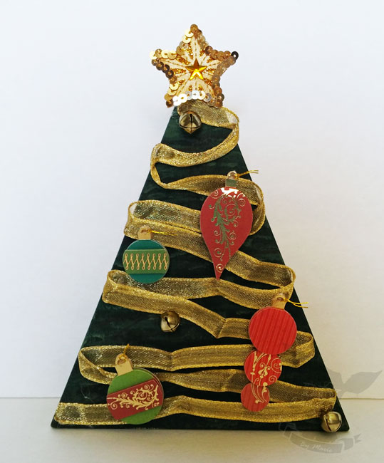 Re-purpose your holiday decor and make this Christmas tree from a wooden candy corn!