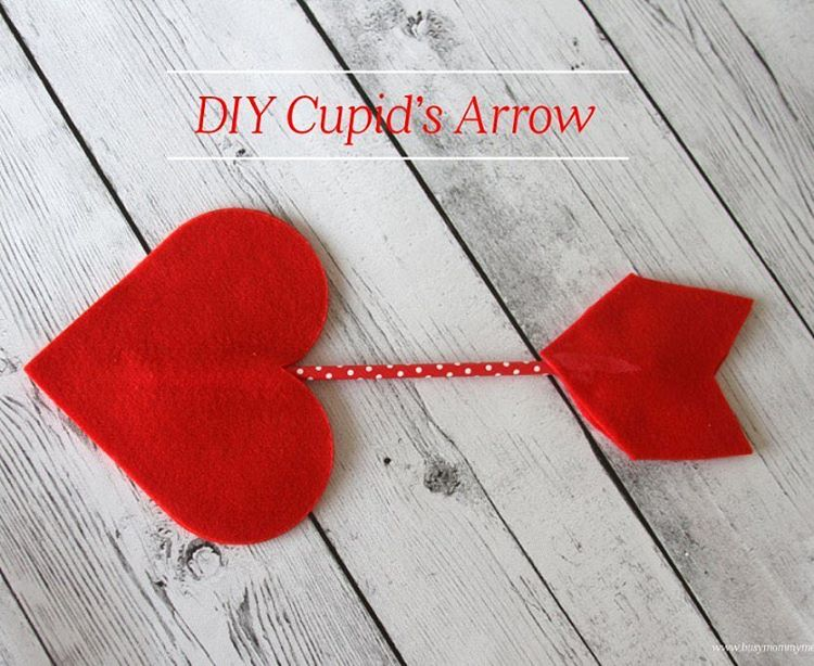 This DIY Cupid's Arrow is such a cute craft for Valentine's Day. We hung this up in our window when we were done and it looks so adorable! Check out the link in our profile to find out how to make this. #valentine #Valentinesday #craft #valentinesdaycraft #holiday #decor #frugaldecor #handmade #DIY #maker #craftsblogger #feltcraft #kidscrafts