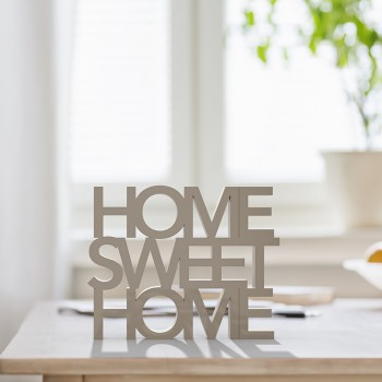 Table top with letters making the words home sweet home