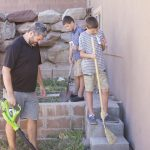 Boys working with dad