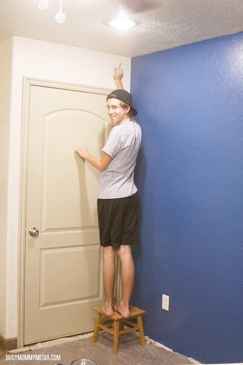 teenager painting a room